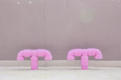 Pipe odor trap on the building. Royalty Free Stock Photo