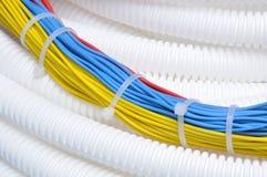 Pipe ondulée avec des câbles image libre de droits