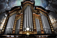 Pipe organ. Detail look of a historic pipe organ in church Stock Images