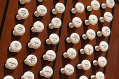 Pipe Organ. Close up view of the stop knobs of a church pipe organ Stock Photos