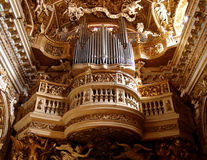 Pipe organ. Ancient pipe organ in a richly decorated church in Rome, Italy Stock Photos