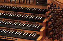Pipe organ keyboard. Vintaghe pipe organ keyboard with stops Stock Photo