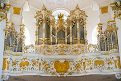 The pipe organ in Pilgrimage Church of Wies. Bavaria, Germany. Stock Photos