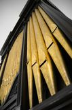 Pipe Organ Pipes. Golden pipes from an old pipe organ still in use Stock Images