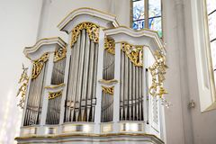 Pipe organs are installed in churches, synagogues, concert halls, schools. The pipe organ is a musical instrument that produces sound by driving pressurized air Stock Images