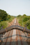 Pipe Over Railway. Rural Scene With Pipe Over Railway Royalty Free Stock Images