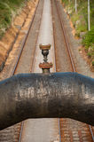 Pipe Over Railway. Rural Scene With Pipe Over Railway Stock Photography