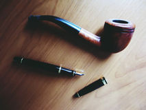 Pipe and pen Stock Image