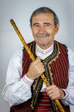 Pipe player in traditional clothing Stock Photography