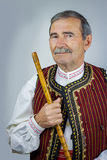 Pipe player in traditional clothing Stock Photo