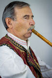 Pipe player in traditional clothing Stock Photos