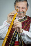 Pipe player in traditional clothing Royalty Free Stock Photos