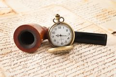 Pipe and pocketwatch Royalty Free Stock Image