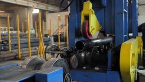 Metal pipe making machine. Pipe production line. Production of metal pipes factory. The process of manufacturing metal pipes on the machine stock video