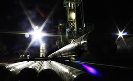 Pipe and rig. Pipes and the rig in the dark Stock Photo