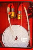 Pipe roll for fire hose emergency in red metal boxes Stock Images