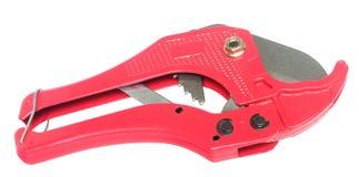 Pipe scissors. Red scissors for cutting plastic pipe Stock Photos