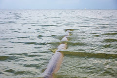 The pipe in the sea Royalty Free Stock Photo