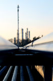 pipe and silhouette of oil refinery Stock Photos