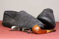 Pipe and slippers Royalty Free Stock Images
