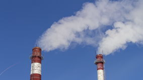 Pipe with smoke against the sky. air pollution by industrial enterprises. the boiler emits steam, global warming stock video footage