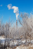 Pipe with smoke of a factory in winter Stock Photography
