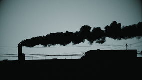 Pipe with a smoke at sunrise. Black and white 4K UltraHD video stock footage