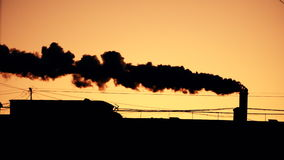 Pipe with a smoke at sunrise stock video footage