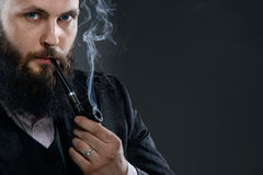 Pipe smoker Stock Image