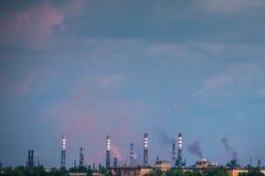 Pipe smokestack industrial city panorama Stock Photos