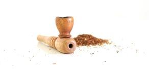 Pipe for smoking marijuana, dry milled leaves. Wooden pipe for smoking marijuana, dry milled leaves Stock Photos