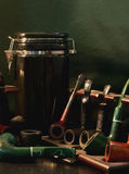 Pipe still-life. Still-life of old,dusty smoking pipes and tobacco jar Stock Images