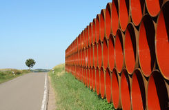 Pipe Symmetry Red. Pipes for a new gas pipeline wait on a field in the Palatine area of Germany Stock Images
