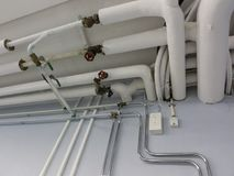 Pipe system in laundry room Stock Image