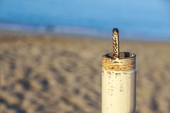 Pipe threaded both isolated on beach at background.  stock photos