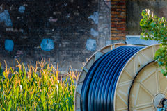 Pipe to irrigate the fields wound on the spool Royalty Free Stock Photos