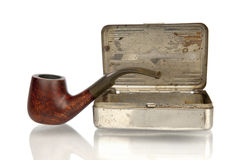 Pipe with tobacco box  in white Royalty Free Stock Photography