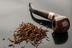 Pipe with tobacco on the dark table Royalty Free Stock Image