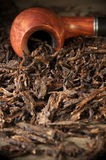 Pipe on tobacco pile Royalty Free Stock Image