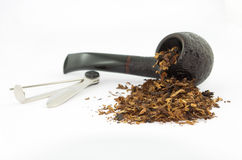 Pipe, tobacco and rammer. Isolated on white background royalty free stock image