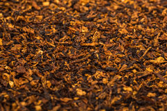 Pipe tobacco spilled on a flat surface. Leaving in perspective Stock Images