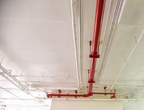 Pipe under the modern building. White and red pipe under the modern building Stock Photo