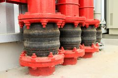 Pipe Vibration Isolator at Ground Entry. Pipe Vibration Isolator of the Fire Water Pipe at Ground Entry providing flexibility to the piping when the pipe vibrate Royalty Free Stock Photo