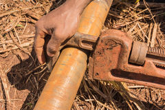 Pipe was locked by pipe wrench. Royalty Free Stock Images