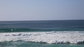 Pipe waves and surfers stock video