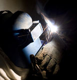 Pipe welder. In work using welding protective helmet Stock Image