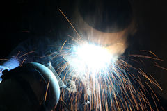 Pipe Welder. In work with arc welding Stock Photo