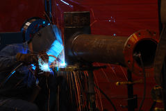 Pipe Welder. Close Up of Pipe Welder joining 2 weld tees together Stock Photo
