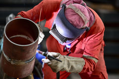 Pipe welding. Welder at Work on Outdoor Pipeline Project Stock Photography