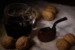 Pipe, wine and walnuts royalty free stock photo
